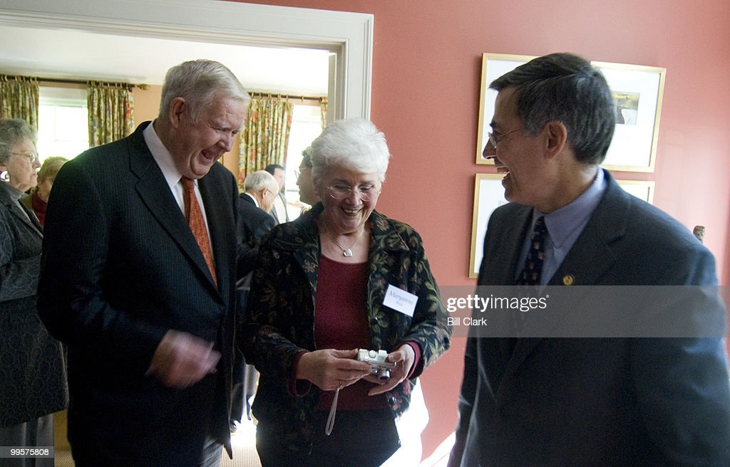 Rep. John Murtha, D-Pa., left, laughs as he realizes he has just posed for a photo with Mrs. Bush, center, Maryanne Bush that is, during a fundraising event for Rep. Rush Holt, D-N.J., right, in the home of David and Catherine Loevner in Princeton, N.J., on Friday, Oct. 13, 2006.