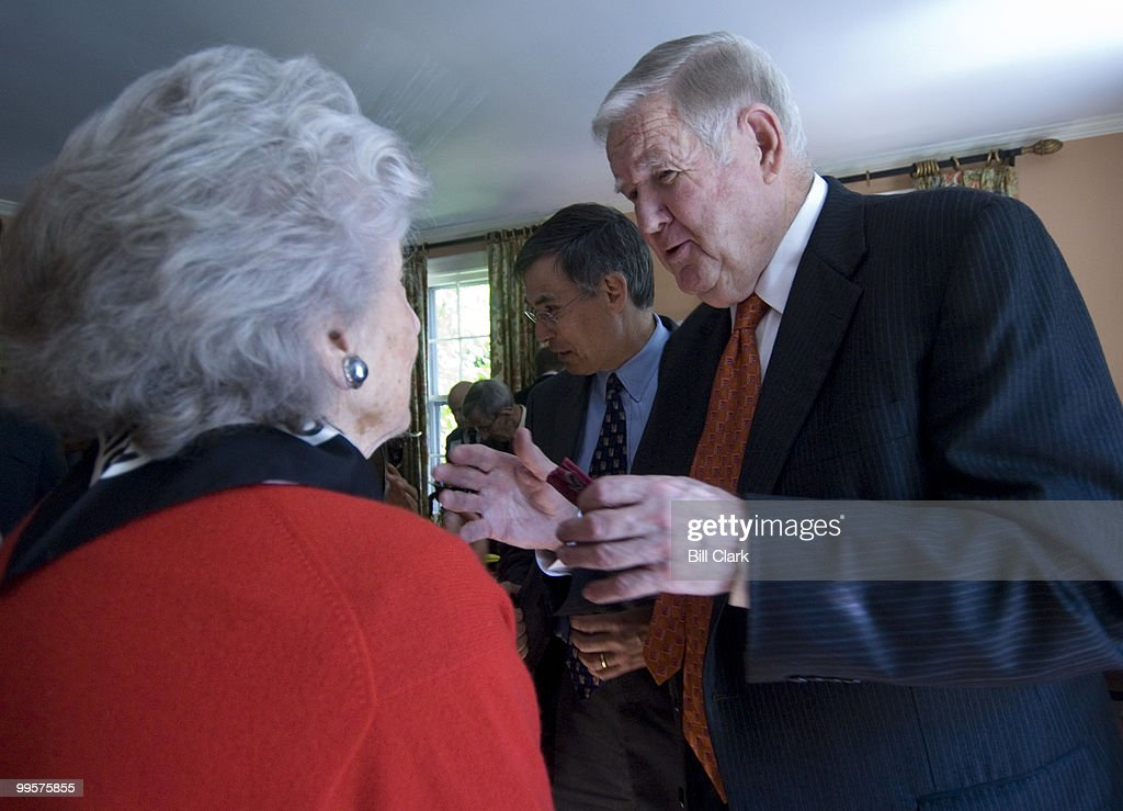 Rep. John Murtha, D-Pa., right, mingles with guests during a fundraising event for Rep. Rush Holt, center, in the home of David and Catherine Loevner in Princeton, N.J., on Friday, Oct. 13, 2006.