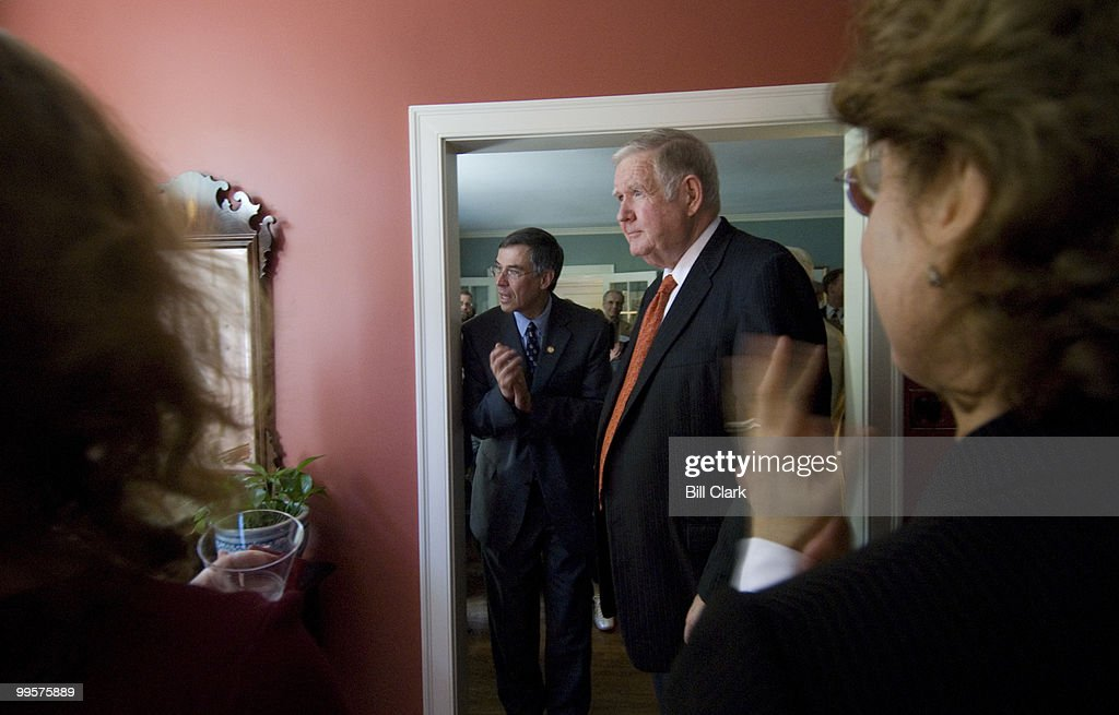 Rep. John Murtha, D-Pa., right, speaks to guests during a fundraising event for Rep. Rush Holt, D-N.J., left, in the home of David and Catherine Loevner in Princeton, N.J., on Friday, Oct. 13, 2006.