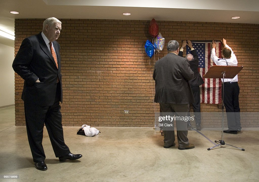 Rep. John Murtha, D-Pa., waits to give a news conference as a flag is hung as a backdrop during the 2006 Jefferson-Jackson Day Dinner at the Lebanon Expo Center in Lebanon, Pa., on Friday, Oct. 13, 2006.