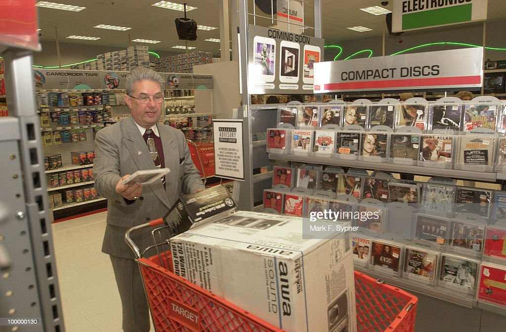 Rep. John Peterson (R-PA) adds a compact disk to the shopping cart at Target on Wednesday, perfect company for his new stereo.