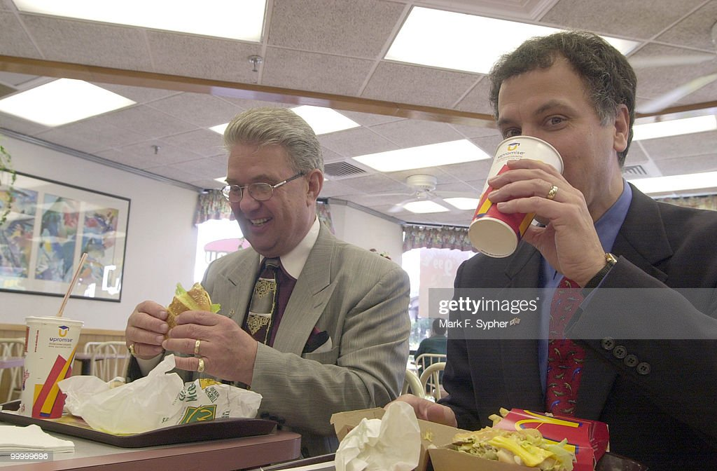 Rep. John Peterson (R-PA) eyes is McChicken hungrily while Rep. Mark Kennedy (R-MN) washes his Big Mac down with a swig of Coke. The two congressman began their day at a McDonalds in Alexandria before heading to Target to shop, in an effort to boost the lagging economy.