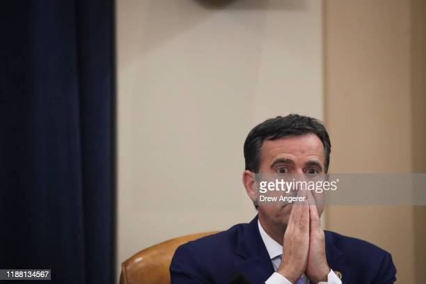 S Rep John Ratcliffe listens during a House Judiciary Committee markup hearing on the articles of impeachment against US President Donald Trump in...