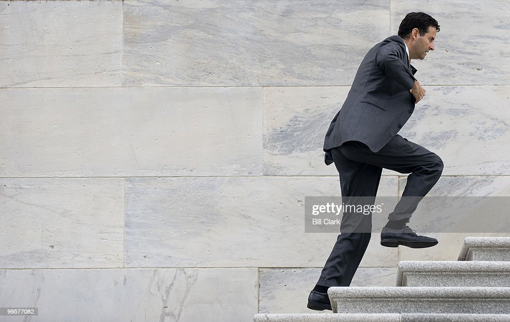 Rep. John Sarbanes, D-Md., runs up the House Steps for a vote on Friday morning, Oct. 23, 2009.