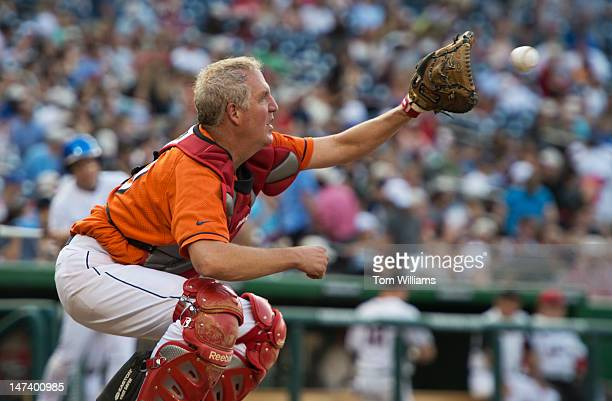 Rep John Shimkus RIll catches a warm up pitch during the 51st Annual CQ Roll Call Congressional Baseball Game held at Nationals Park The Democrats...