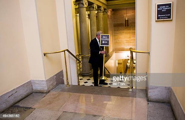 Rep John Shimkus RIll jokingly hides from the camera by hiding behind a sign as he leaves the House Republican Conference meeting in the Capitol on...