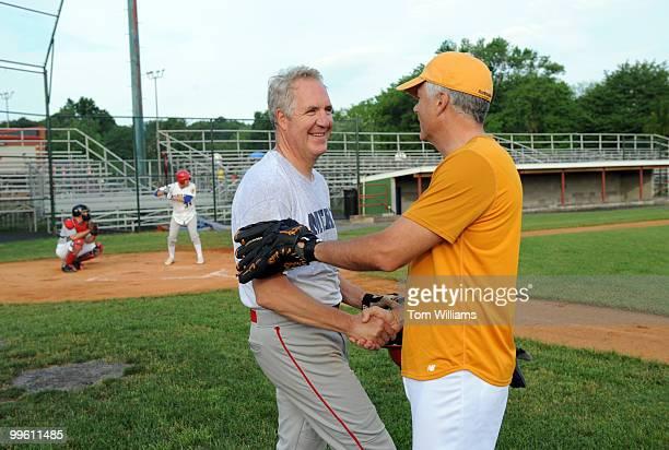 Rep John Shimkus RIll left greets Sen John Ensign RNev during Republican baseball practice at Four Mile Run Park in Virginia June 11 2008
