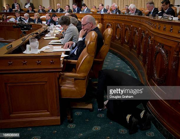 Rep Joseph Crowley DNY listens as one of his staffers writes him a note during the testimony at the House Ways and Means committee hearing on...