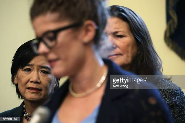 S Rep Judy Chu and Rep Diana DeGette listen to a speaker during a news conference October 26 2017 on Capitol Hill in Washington DC The Congressional...