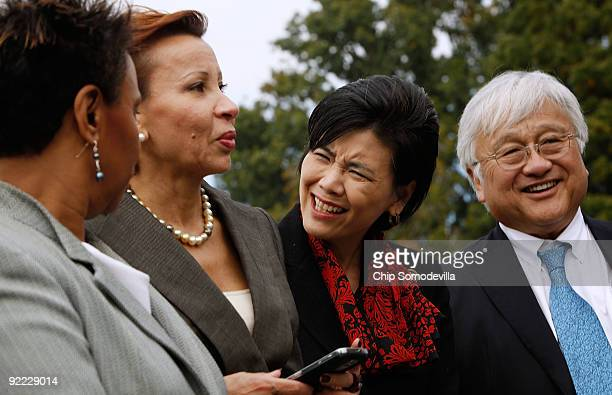 Rep Judy Chu reacts as Congressional Black Caucus chair Rep Barbara Lee and Congressional Hispanic Caucus chair Rep Nydia Velazquez inform her of Sen...