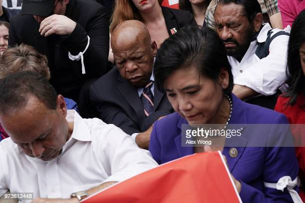 S Rep Judy Chu Rep Al Green Rep John Lewis and Rep Luis Gutierrez participate in a moment of silence outside the headquarters of US Customs and...