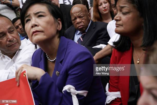 S Rep Judy Chu Rep Pramila Jayapal Rep John Lewis and Rep Luis Gutierrez block the entrance of the headquarters of US Customs and Border Protection...