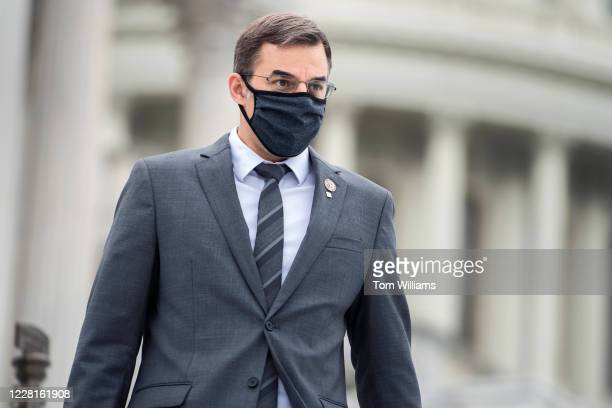 Rep. Justin Amash, I-Mich., leaves the Capitol as the House voted on a bill to ban changes to U.S. Postal Service operations and provide $25 billion...