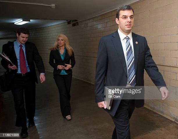 Rep Justin Amash RMichholds his iPad as he walks with staff to the House Oversight and Government Reform Committee hearing on 'The Future of Capital...