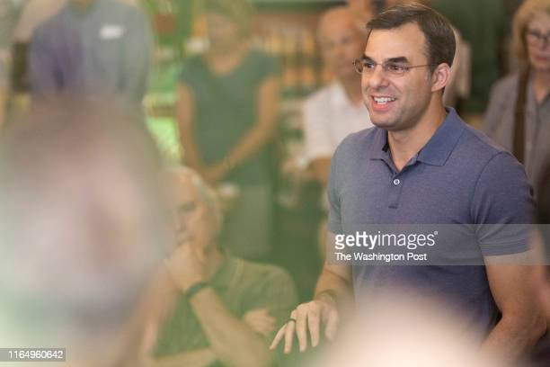 Rep. Justin Amash speaks with constituents at Common Ground, a coffee shop in Grand Rapids, on Wednesday, Aug. 21, 2019.