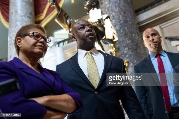 Rep. Karen Bass , Sen. Tim Scott , and Sen. Cory Booker speak briefly to reporters as they exit the office of Rep. James Clyburn following a meeting...