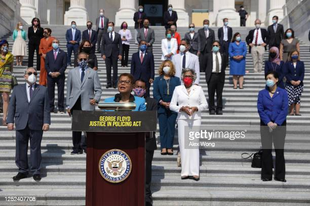 Rep. Karen Bass speaks as other House Democrats listen during an event on police reform June 25, 2020 at the east front of the U.S. Capitol in...