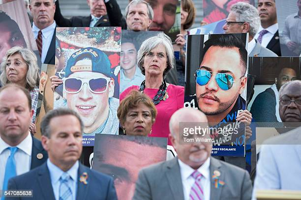Rep Katherine Clark DMass center attends a vigil on the House steps of the Capitol at which members held up pictures of the Orlando nightclub victims...