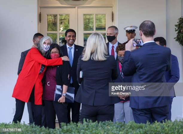 Rep. Katherine Clark hugs Rep. Pramila Jayapal as a group of progressive lawmakers takes a group photo following a meeting with President Joe Biden...