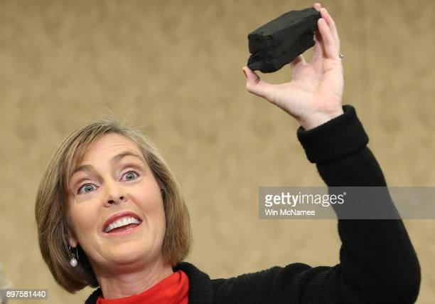 Rep Kathy Castor holds up a symbolic piece of coal for the holiday season during a press conference with the Democratic Women's Working Group on the...