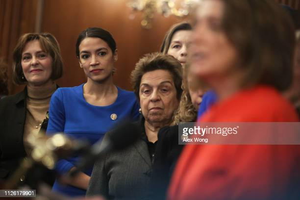 US Rep Kathy Castor Rep Alexandria OcasioCortez and Rep Donna Shalala listen as Speaker of the House Rep Nancy Pelosi speaks during a news conference...