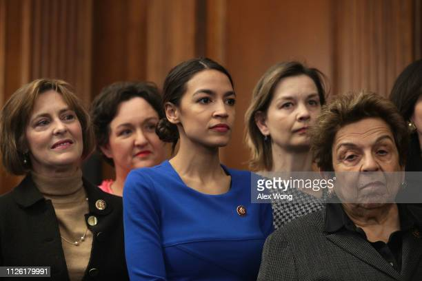 S Rep Kathy Castor Rep Alexandria OcasioCortez and Rep Donna Shalala listen during a news conference at the US Capitol January 30 2019 in Washington...