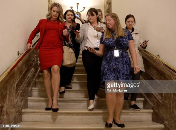 Rep Katie Hill answers questions from reporters at the US Capitol following her final speech on the floor of the House of Representatives October 31...