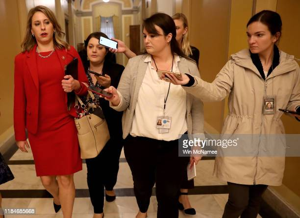 Rep. Katie Hill answers questions from reporters at the U.S. Capitol following her final speech on the floor of the House of Representatives October...