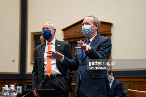 Rep. Ken Buck and Brad Smith, President of Microsoft, before the start of a House Judiciary Subcommittee on Antitrust, Commercial, and Administrative...