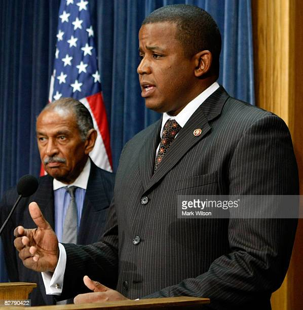 Rep Kendrick Meek and House Judiciary Chairman John Conyers talk about helping hurricane ravaged Haiti during a news conference on Capitol Hill...
