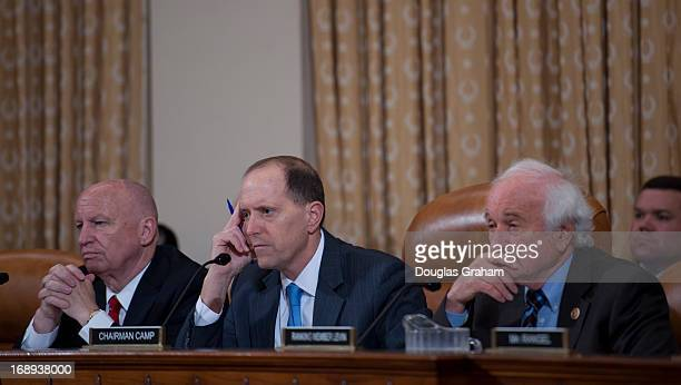 Rep Kevin Brady RTX Chairman Dave Camp RMI and Rep Sander M Levin DMI listen to testimony during the House Ways and Means committee hearing on...