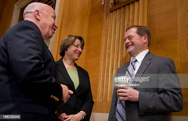 Rep Kevin Brady RTX Sen Amy Klobuchar DMN and Grover Norquist president of Americans for Tax Reform talk before the start of the full committee...
