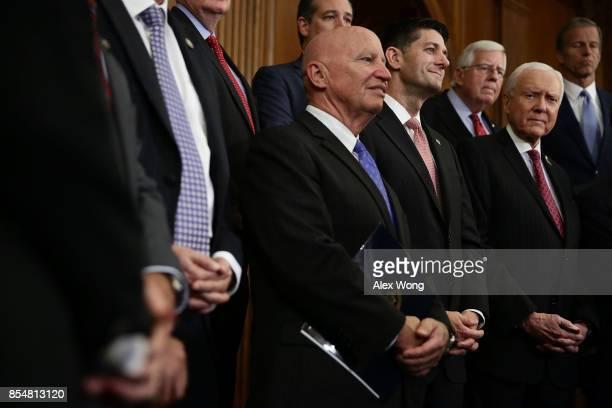 US Rep Kevin Brady Speaker of the House Rep Paul Ryan Sen Orrin Hatch Sen Michael Enzi and Sen John Thune listen during a press event on tax reform...
