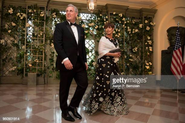 S Rep Kevin McCarthy and his wife Judy arrive at the White House for a state dinner April 24 2018 in Washington DC President Donald Trump is hosting...