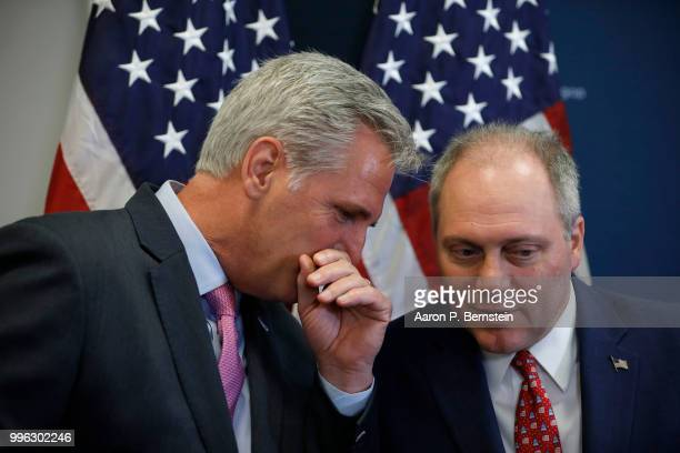 Rep Kevin McCarthy House Majority Leader speaks with Rep Steve Scalise during a news conference following a House Republican conference meeting July...