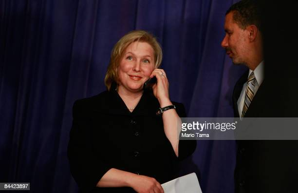 S Rep Kirsten Gillibrand takes a congratulatory call from President Barack Obama as New York Gov David A Paterson during a news conference announcing...