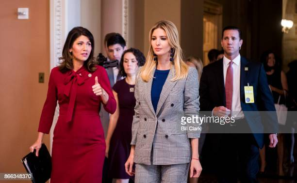 Rep Kristi Noem RS Dak left speaks with Ivanka Trump as they walk through the Capitol en route to a press conference on child tax credits on...
