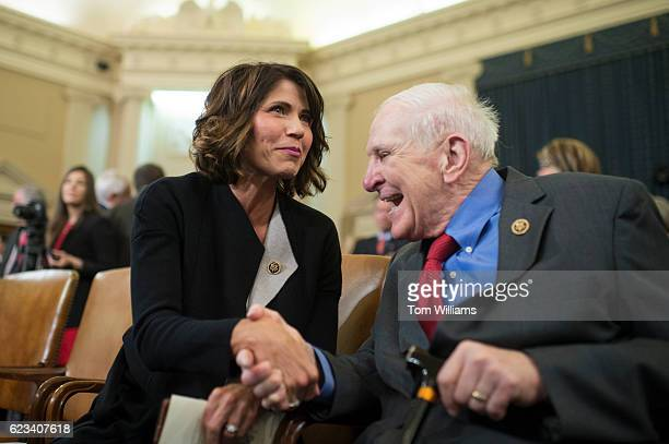 Rep Kristi Noem RSD greets Rep Sam Johnson RTexas during a ceremony in the House Ways and Committee hearing room to dedicate a room in Rayburn...