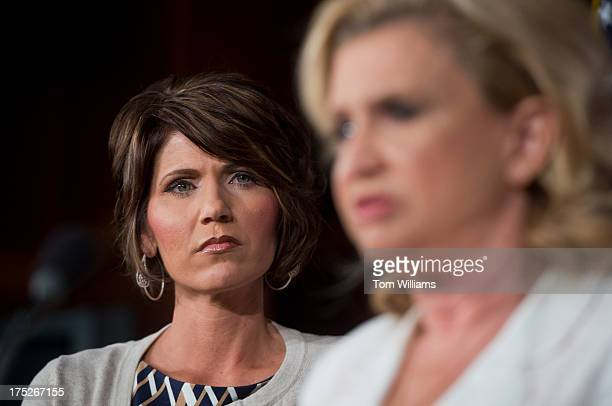 Rep Kristi Noem RSD left and Carolyn Maloney DNY conduct a news conference in the Capitol on legislation to reduce human trafficking by targeting...