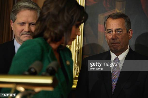 Rep. Kristi Noem turns away from the podium as Speaker of the House John Boehner and Sen. John Hoeven during a signing ceremony of the Keystone XL...
