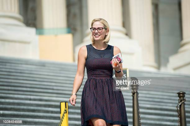 Rep Kyrsten Sinema DAriz walks down the House steps after the last vote of the week on Friday Sept 7 2018