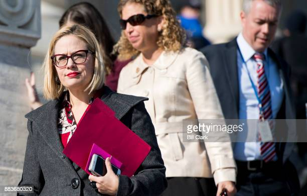 Rep Kyrsten Sinema DAriz walks down the House steps following a vote in the Capitol on Friday Dec 1 2017