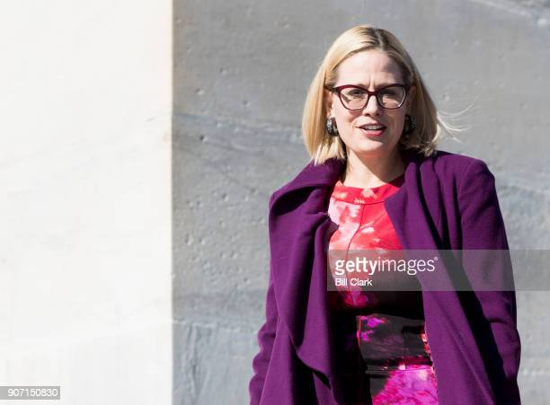 Rep Kyrsten Sinema DAriz walks down the House steps following the final scheduled votes of the week on Friday Jan 19 2018 House members were told to...