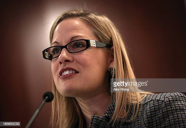 S Rep Kyrsten Sinema speaks during a discussion on immigration reform October 23 2013 on Capitol Hill in Washington DC The Dream Action Coalition...