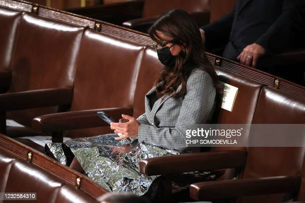 Rep. Lauren Boebert looks at her phone as US President Joe Biden addresses a joint session of Congress at the US Capitol in Washington, DC, on April...