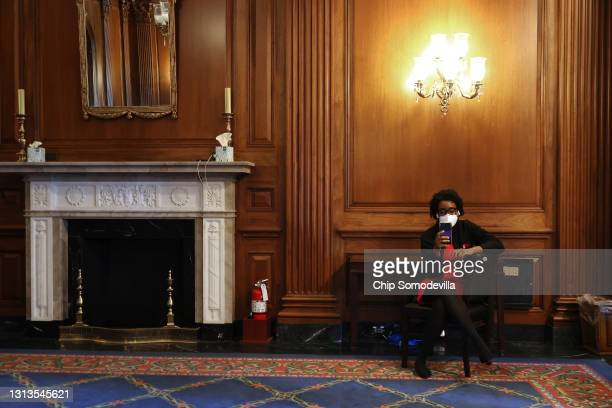 Rep. Lauren Underwood watches the announcement of the verdict in the Derek Chauvin murder trial on her phone in the Rayburn Room at the U.S. Capitol...