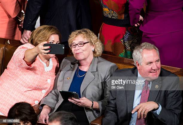 Rep Linda Sanchez DCalif takes a selfie with Rep Zoe Lofgren DCalif as Rep John Shimkus RIll looks on before President Barack Obama's State of the...