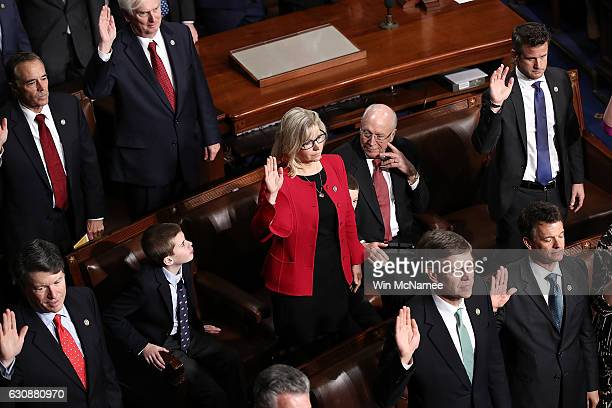 Rep Liz Cheney takes her oath of office as her father former US Vice President Dick Cheney looks on during the first meeting of the 115th Congress...