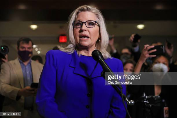 Rep. Liz Cheney talks to reporters after House Republicans voted to remove her as conference chair in the U.S. Capitol Visitors Center on May 12,...