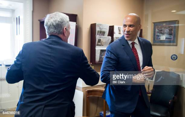Rep Lloyd Doggett DTexas and Sen Cory Booker DNJ give an elbow bump greeting as they gather for a news conference on legislation that will allow for...